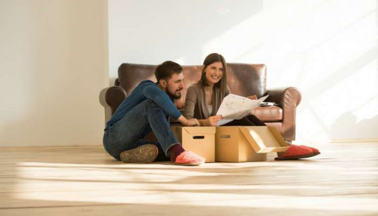 new home checklist: couple moving into new house