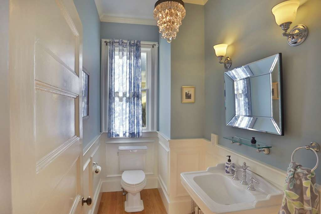 powder room with hardwood floors and pedestal sink