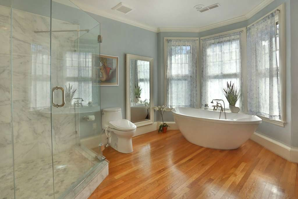 beautiful bathroom with hardwood floors and clawfoot tub