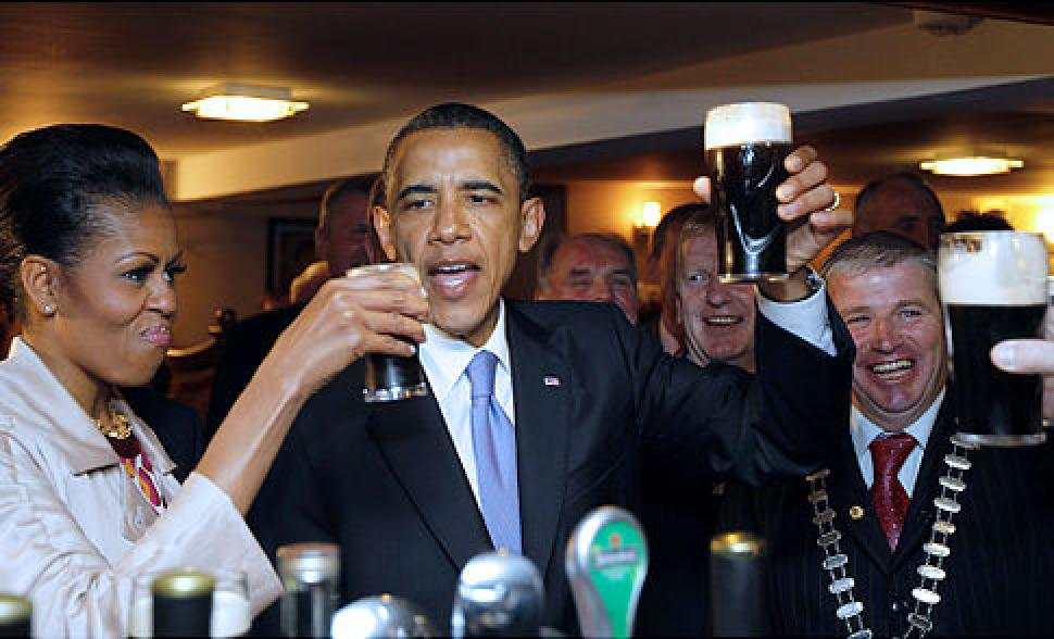 president obama toasts with guinness in hand