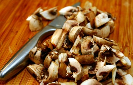 chopped mushrooms on cutting board - best housewarming gifts