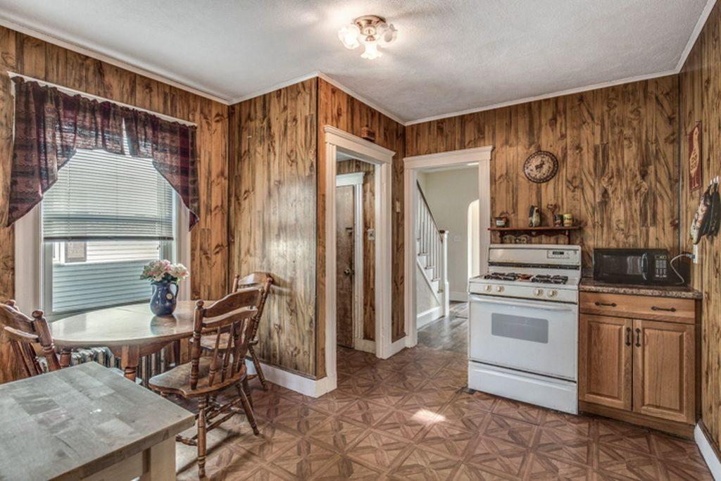 kitchen with faux wood paneling