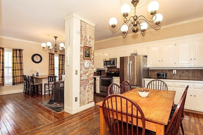 house for sale in lowell - exposed brick in kitchen
