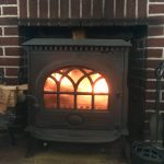 wood stove or fireplace - fire in woodburning stove in hearth