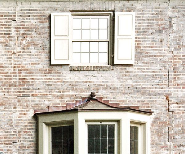 faded limewash on brick exterior