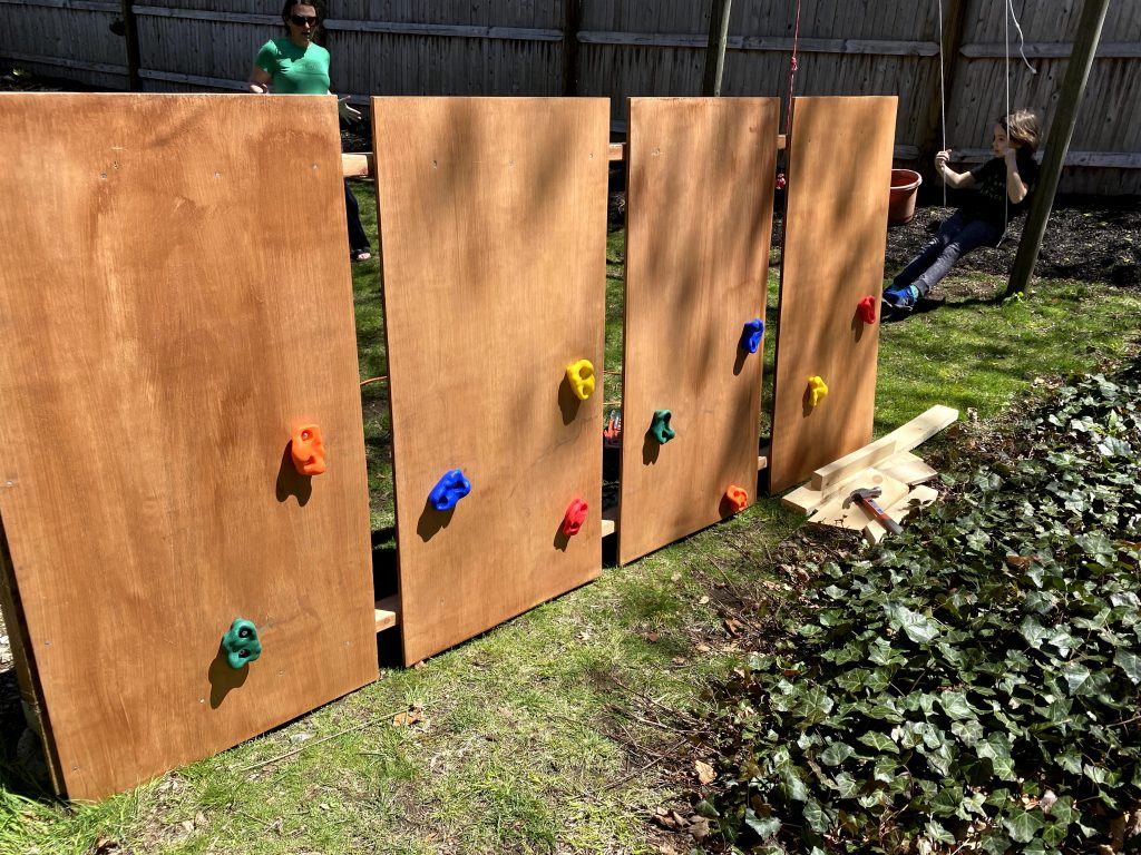how to make a DIY rock climbing wall with 2x4 sheets of plywood