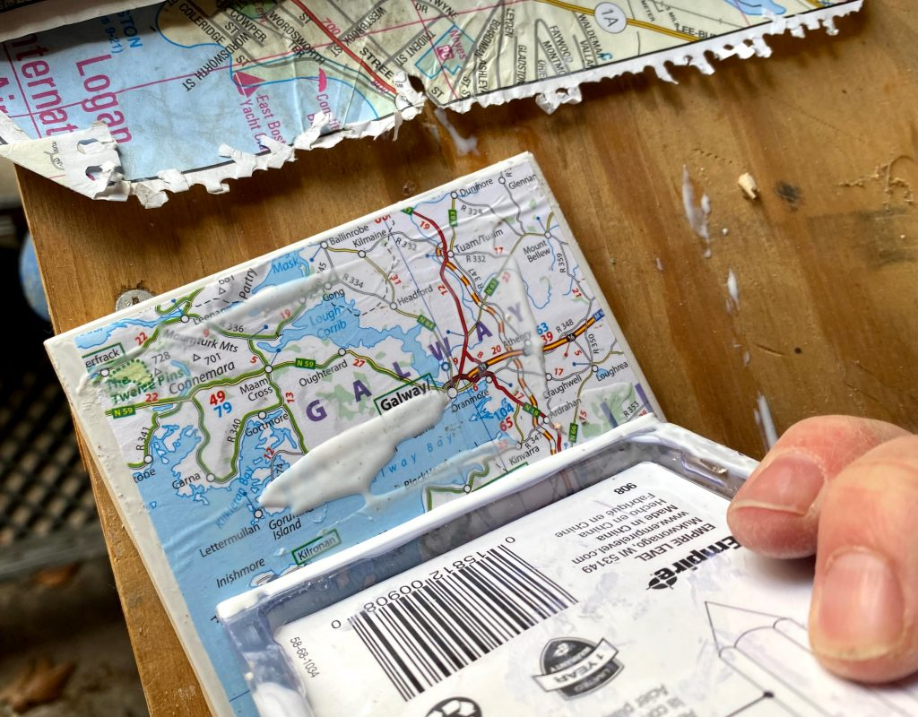 squeeze out excess mod podge on your map coasters