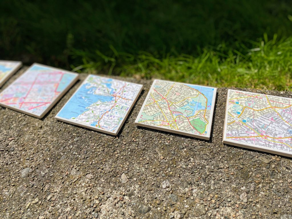 homemade map coasters sitting in the sun to dry