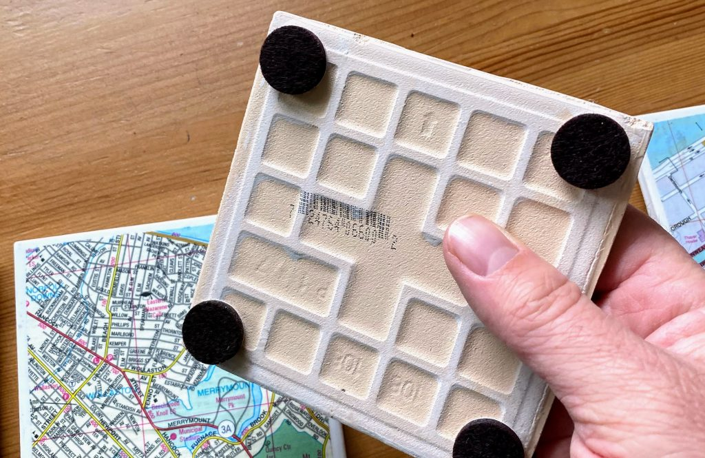 apply felt backing pads to the bottom of the tile coasters