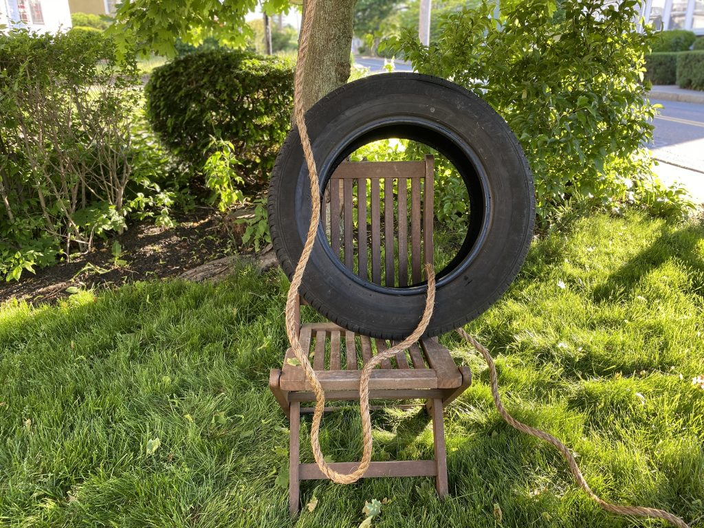 raising the tire swing on a chair will make it easier to tie a knot