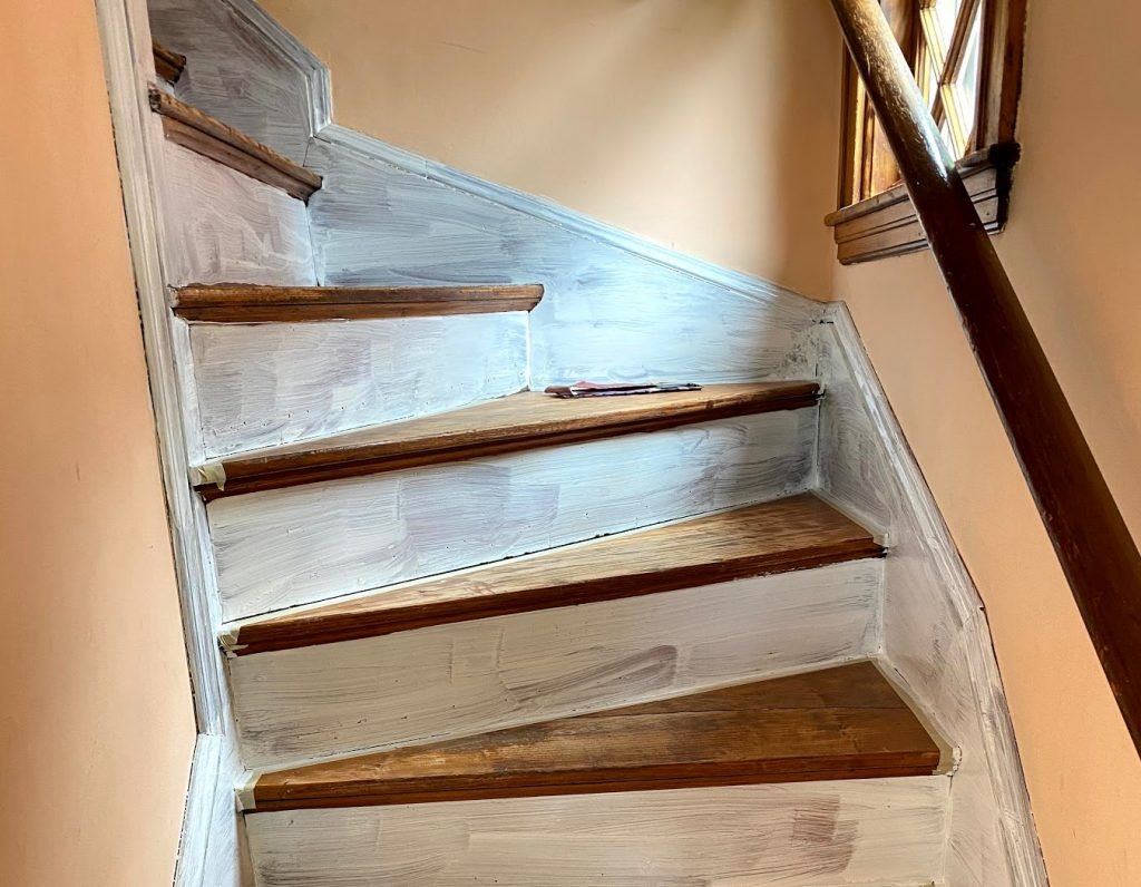 prime the exposed wood of the baseboard trim and risers with at least two coats